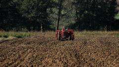 5. Sowing. Agriculture. Seeder in a field. Sower with tractor preparing land. Stock Footage