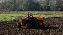 14. Sowing. Agriculture. Seeder in field. Tractor passing through the shot. Wide Stock Footage