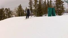 Skier with helmet at ski resort slow motion Stock Footage