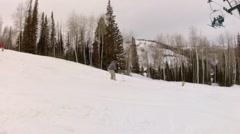 man skis on moguls at a mountain resort - stock footage