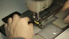 Sewing machine. Man sews clothes. Close up. Stock Footage
