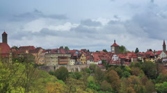 Rothenburg on Tauber cityscape above the forest, cloudy timelapse Stock Footage