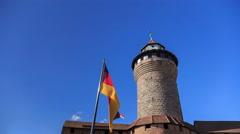 Nuremberg Castle (Sinwell tower) with blue sky and german flag timelapse Stock Footage