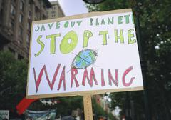 Close-up of global warming sign in city Stock Photos