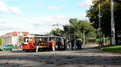 Vintage tram leaves station - city (urban street) - people Stock Footage