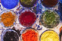 High angle view of various powder paints in plates on Holi festival Stock Photos