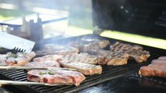 Barbeque grilling lamb chops Stock Footage