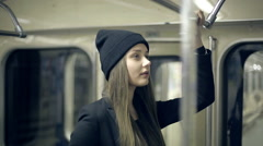 Teen girl rides the metro at night - stock footage