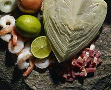 Close-up of prawns and sliced meat with vegetables on rock Stock Photos
