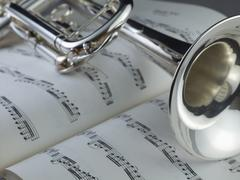 Close-up of trumpet on sheet music Kuvituskuvat