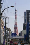 Tokyo Tower seen from city street against clear sky Kuvituskuvat
