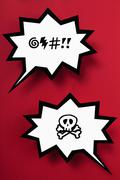 Curse and danger speech bubbles against red background Stock Illustration
