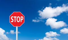 roadside red stop sign on a cloudy background. - stock illustration