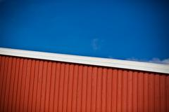 Geometrical shot of house wall on sky background Stock Photos