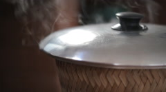 Stick rice boil steam in weaving bamboo and pot, HD Clip. Stock Footage