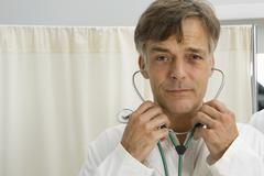 Stock Photo of Portrait of doctor with stethoscope in hospital ward
