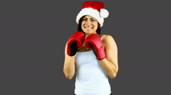 Festive brunette boxing to camera Stock Footage