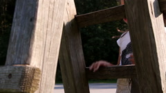 Little girl climbing on a playground equipement - stock footage