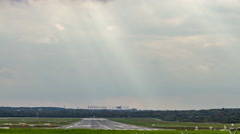 4K Hamburg airport runway with landing and starting aircraft with cloudy sky Stock Footage