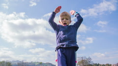 Kid waving and jumping around Stock Footage