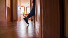 Stock Video Footage of Boy run in to a room at home in slow motion