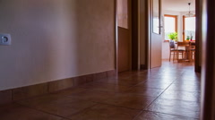 Kid crashing in to wall running to another room in slow motion - stock footage