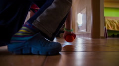 Setting and kicking ball in door goal at home Stock Footage