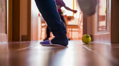 Soccer game at home hallway in slippers Stock Footage