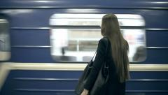 Girl teenager waiting for the subway train waits and comes aboard - stock footage