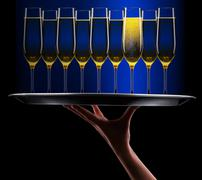 Waiter hand with champagne Stock Photos