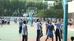 Chinese students in the playground physical education Stock Footage