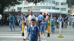 Shenzhen, China: primary school, the students out of the school gate Stock Footage