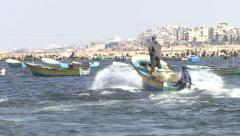 Palestinian fishermen on a motor boat in the Gaza City port Stock Footage