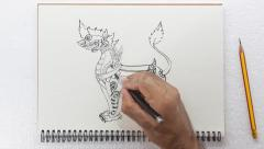 Speed drawing,thai traditional art lion, pen on paper Stock Footage