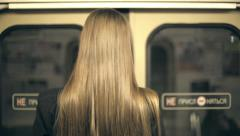 Girl teenager riding in a train and get off at. Stock Footage