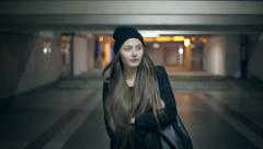 Girl teenager goes at night in the underpass - stock footage