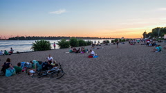 4K Hamburg Elbe river with sand beach in the evening - DSLR dolly shot timelapse - stock footage