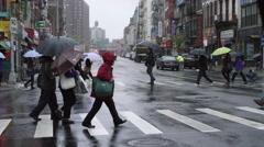 People Crossing Street Crosswalk NYC Slow Motion Chinatown Umbrellas Rain 4K Stock Footage