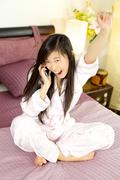 asian woman feeling successful on the phone - stock photo