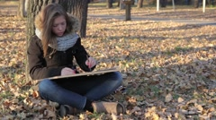 The girl draws in autumn Park (2) Stock Footage