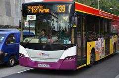 Stock Photo of bus travel on the singapore street