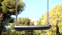 Empty Playground Swing in a Park Stock Footage
