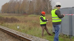 Worker with warning tape on railway Stock Footage