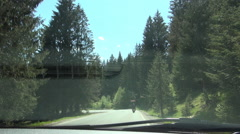 Timelapse with a car on a mountain road in a holiday trip. - stock footage