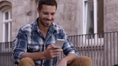 Man Using Cell Phone To Send Message Stock Footage