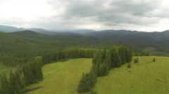 Flight over   hill and wood  in mountains. Aerial  with turn - stock footage
