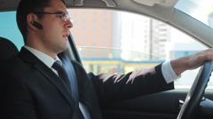 Businessman Talking on a Handsfree Safe Driving Concept Stock Footage