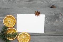 Spruce twig with dried orange slices and greeting card Stock Photos