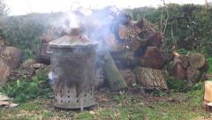 Smoking Incinerator Burning Garden Rubbish - Yardwork Gardening - stock footage
