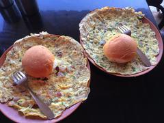 India, Maharashtra, Breakfast in roadside garage consisting of masala omelet and - stock photo